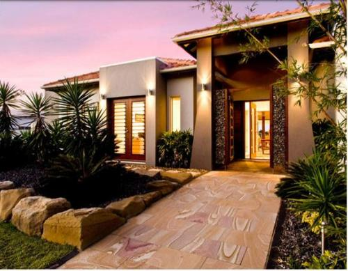 taman minimalis depan rumah dengan batu-batu alam