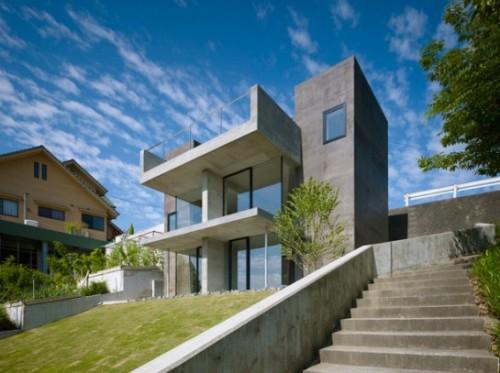 model rumah minimalis modern 2 lantai di lahan miring