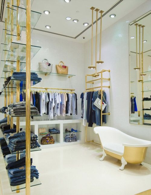 Interior distro dengan rak transparan - Retail Design Blog (Pinterest)