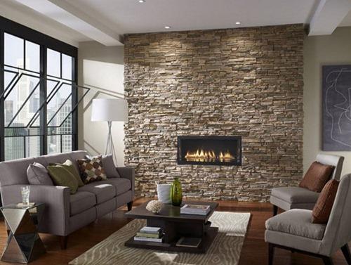 Contoh aplikasi dinding batu alam di ruang tamu (Creativedesignmagazine)