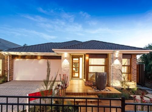 rumah minimalis dengan batu alam pada bagian kolom - Houseandland